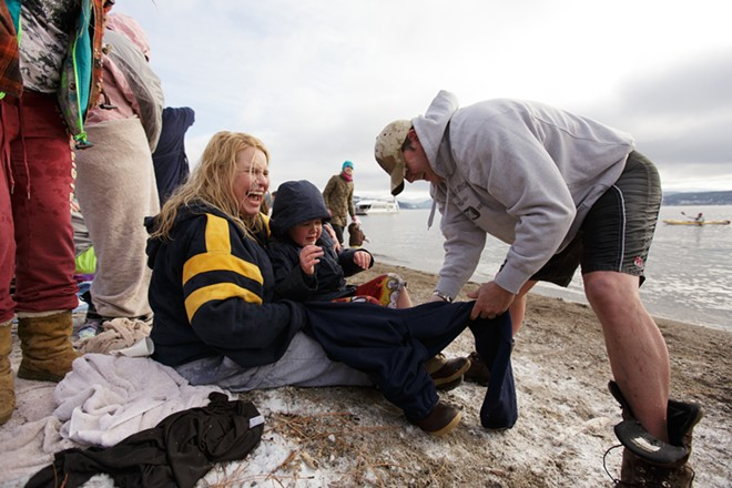 Kerry Johnson, left, helps her brother Michael Green, right, dress his 7 year old son Joshua, after the Polar Bear Plunge. - YOUNG KWAK