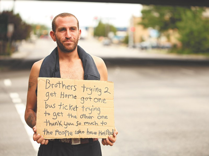 Kevin, who didn\'t give his last name, panhandles at Fifth Avenue and Walnut Street in Spokane. He says he\'s trying to get bus tickets for him and his brother to go home to California - YOUNG KWAK
