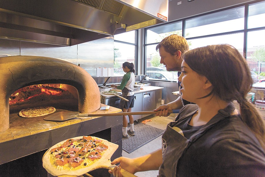 Konstantin Kushner and Jillian McCann cooking with the new restaurant's wood-fire oven. - MATT WEIGAND