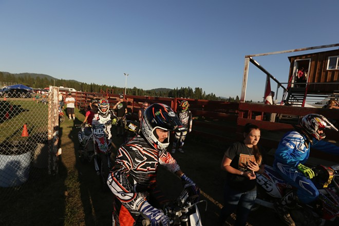 Lagrange, Calif. 250 cc pro rider Brian Alquist, left, waits to enter the track before a Moto 1 race. - YOUNG KWAK