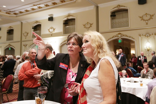 LeAnn Grant, left, and Helena Griswold monitor election results. - YOUNG KWAK