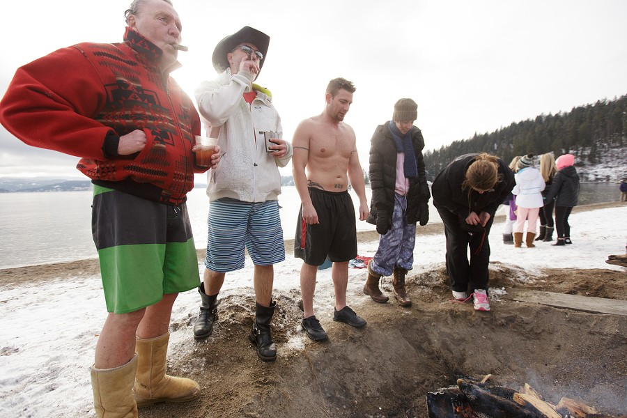 (Left to right) Robert Cliff, Brad Hoppie, Brandon Spry, Megan Hodges and Debby Dotson stand in front of a bonfire after the Polar Bear Plunge. - YOUNG KWAK