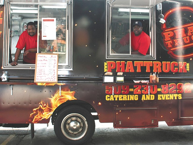 LeSean Grant (left) and Avont Grant slinging burgers on Sprague.| - AYAAN THOMAS