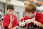 Liberty Lake Elementary School 3rd graders Ansel Lapier, left, and Spencer Bringhurst assemble their robot, during the 1st Lego League competition.