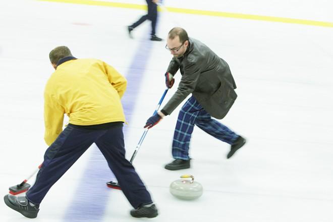 Lilac City Curling Club member Jon Escott, right, and Treasurer Tony Murray sweep. - YOUNG KWAK