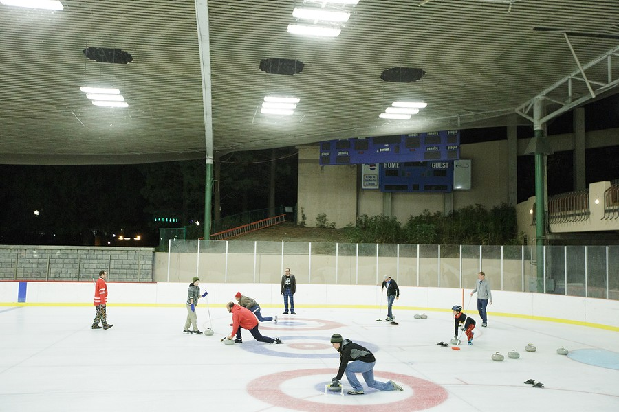 Lilac City Curling Club members teach students during a curling clinic. - YOUNG KWAK