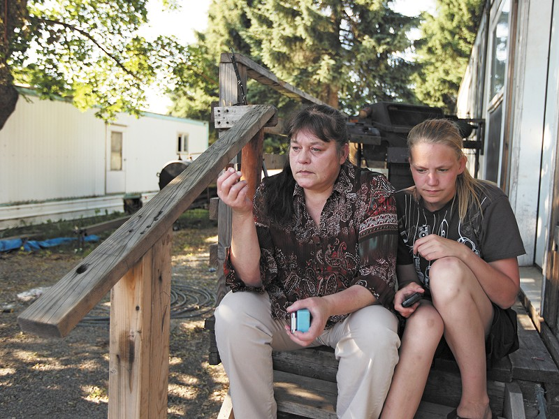 Lisa Cornett, left, and her 23-year-old daughter, Nicole, aren't sure how much longer they'll live in El Rancho Mobile Home Park in Post Falls, Idaho.
