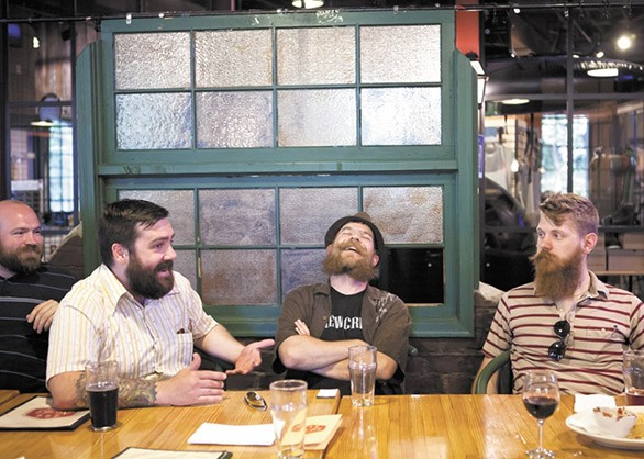 Eric Bandholz, right, at a Spokane Beard and Mustache even. - STEPHEN SCHLANGE