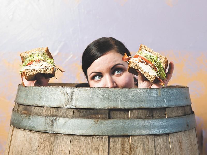 Loretta Haworth with an Unforgettable Nooner sandwich at High Nooner. - STEPHEN SCHLANGE