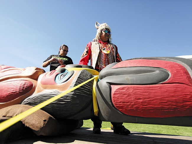 """Lummi tribal members, hauling a """"healing totem,"""" are driving the route that  coal trains would travel. - YOUNG KWAK"""