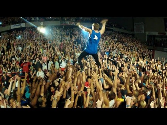 Macklemore crowd surfing at Eastern Washington University in 2013