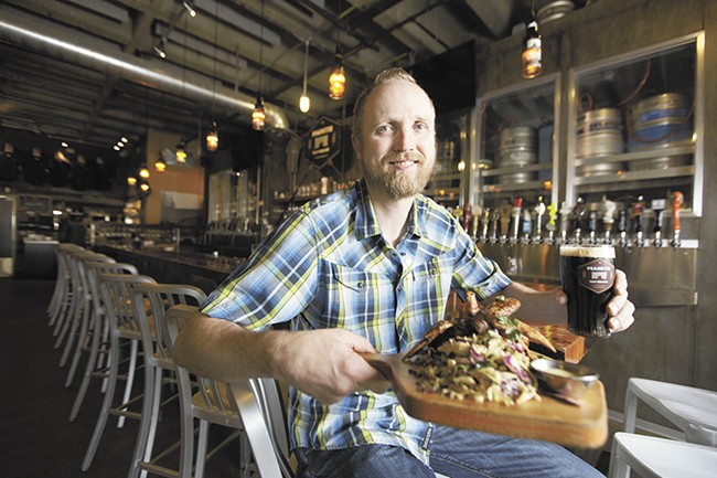 Manito Tap House owner Patrick McPherson employs a staff of highly educated beer experts to help match a pint with your meal. - YOUNG KWAK