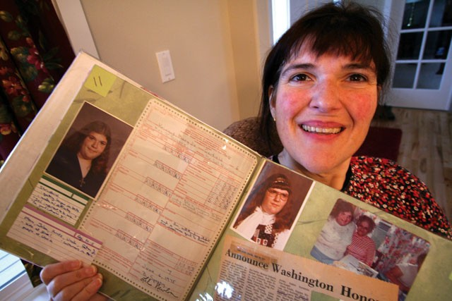 Mary Jo Kringas' scrapbook documents her journey. - TARYN HECKER