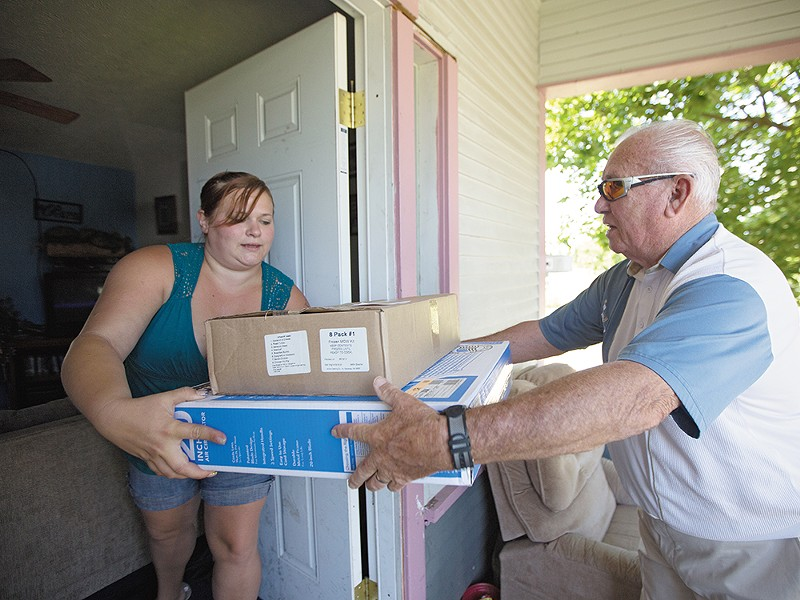 Meals on Wheels volunteer Dick Main delivers fans and food last week. - YOUNG KWAK