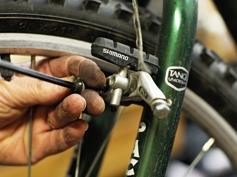 Mechanic Dave Mannino repairs a bicycle at Two Wheel Transit. - YOUNG KWAK