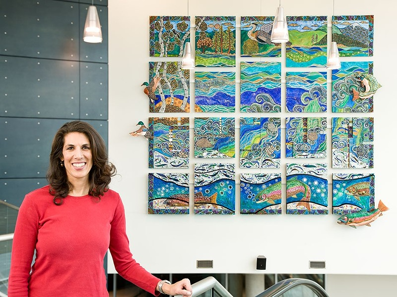 """Melissa Cole in front of her \""""River Dance,\"""" now on display at the JACC."""