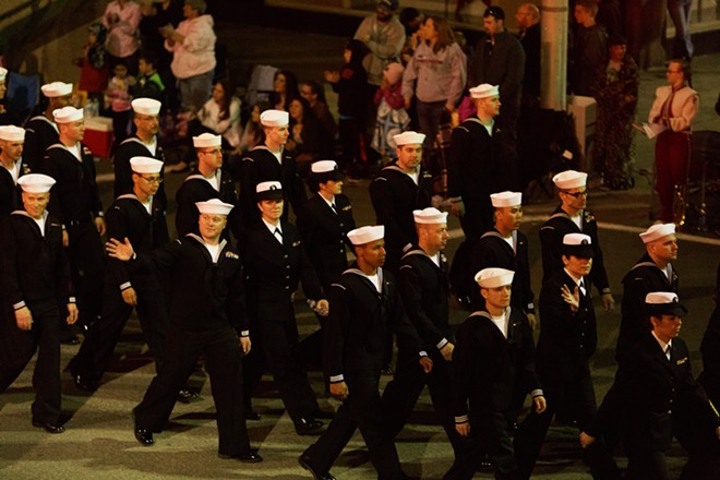 Members of the Navy Reserve march. - YOUNG KWAK