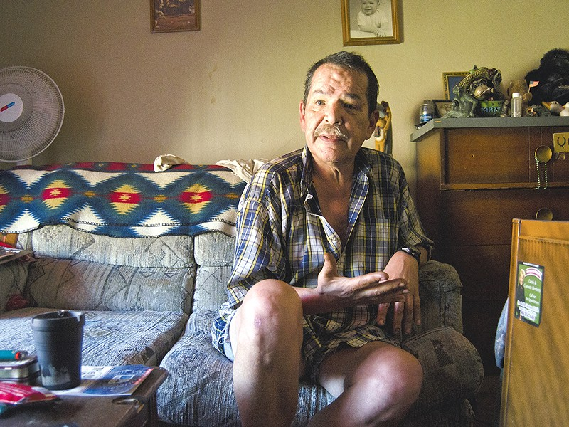 """Michael Devenere, 54, says his unit in the Danmor Apartments may be small, but """"this is home."""" - JACOB JONES"""