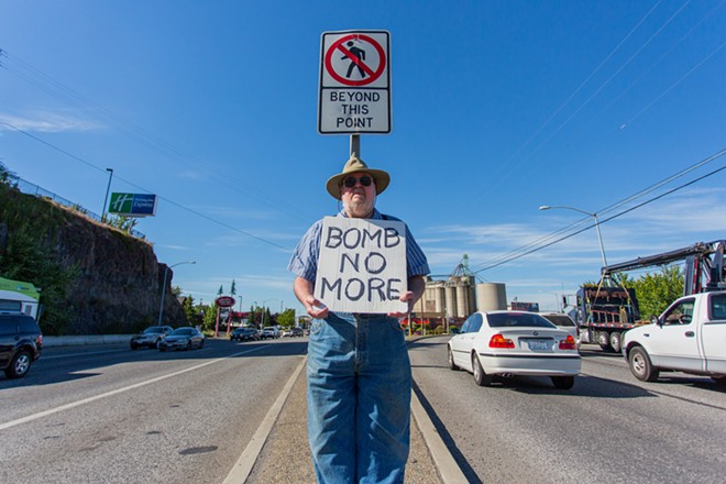 Michael Poulin protests against the threat of bombing Iraq. - MATT WEIGAND