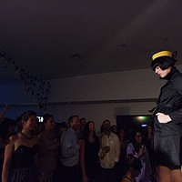 PHOTOS: Olive + Boone Custom Millinery Show Michelle Robertson pauses at the end of the runway. Young Kwak