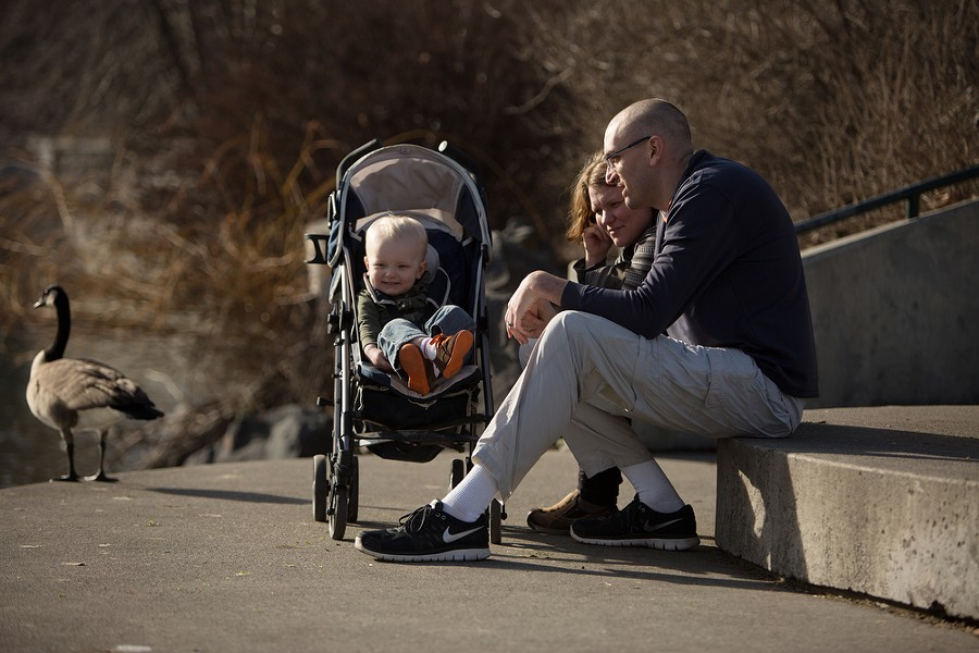 Mike Jouwstra, right, his wife Emma, center, and their 18-month-old son Oren watch ducks and geese. - YOUNG KWAK