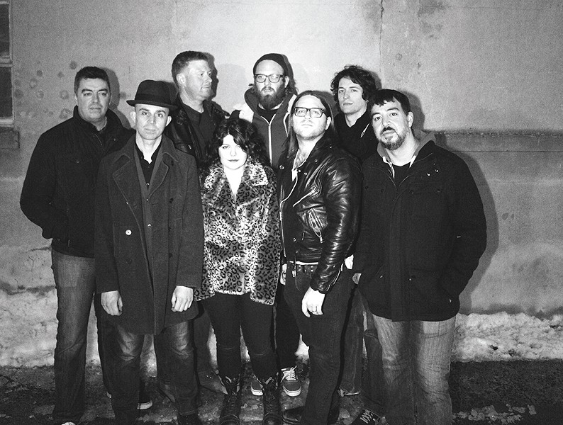 Mike V. , in the back with the beard, stands surrounded by one of the ever-changing Everymen lineups.