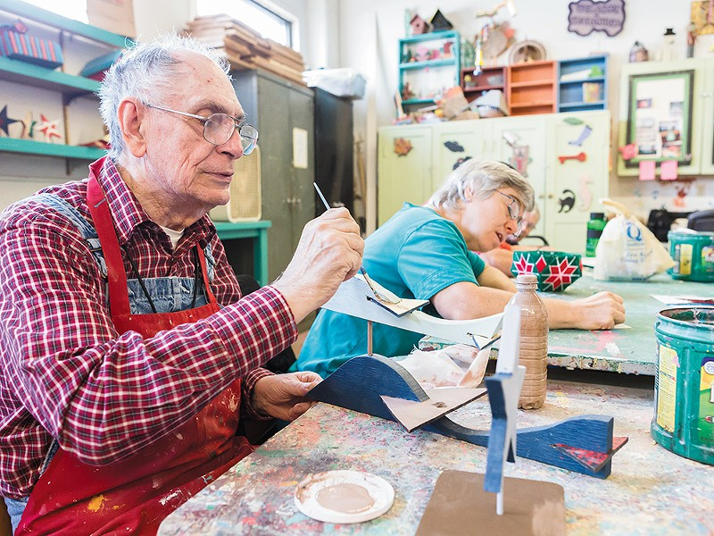 Morris Martin paints his creation in a woodshop class at Center Pointe. - STEPHEN SCHLANGE