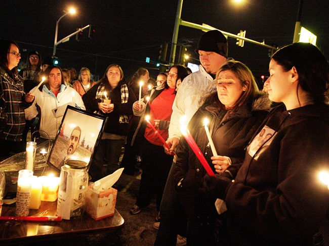 Mourners gather at the candlelight vigil for Jeremy Groom, who was shot by Spokane Police. - YOUNG KWAK