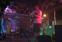 Singer-songwriter Ian Miles performs at Carr's Corner last Friday.
