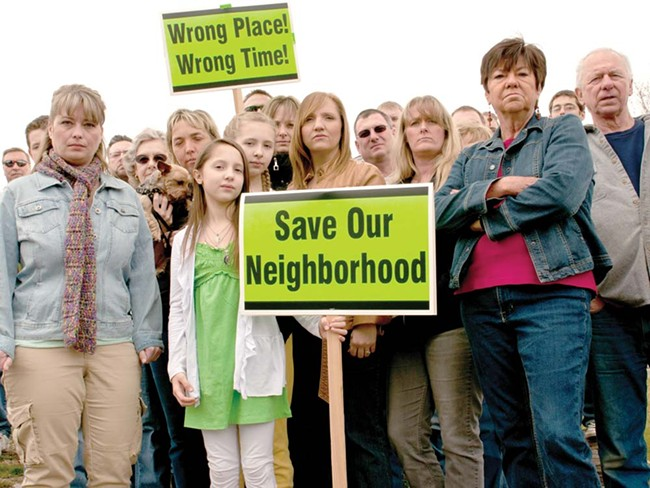 Neighbors who oppose a local church's plan to build an elderly-housing complex. - AMY HUNTER
