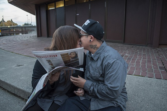 Dylan Ramirez, right, proposing to his fiance Celeste Lennartz, left, with the I Saw You section of the Inlander. - SARAH WURTZ