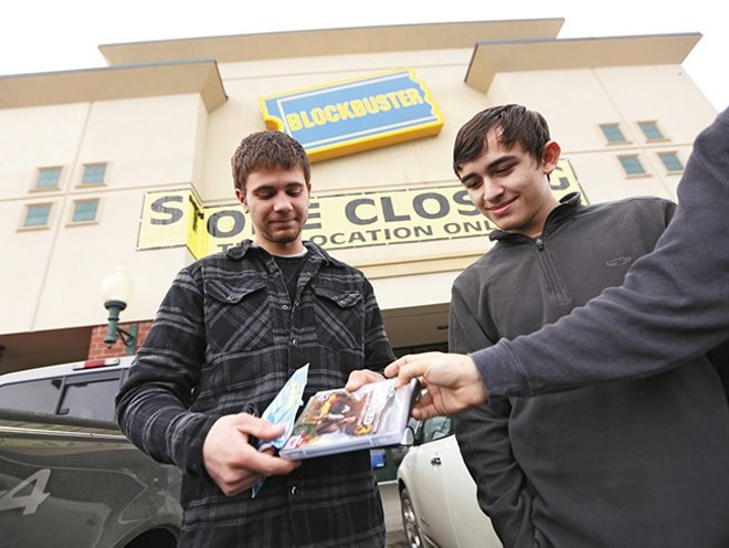 Anthony Schnettler, left, and Giovanni Soto outside of a closing Blockbuster in Cheney earlier this year. - YOUNG KWAK
