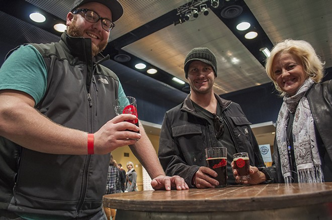 Travis Blanchard, left, Kevin Stone, center, and Donna Walker, right, enjoy the PowderKeg Brew Festival. - SARAH WURTZ