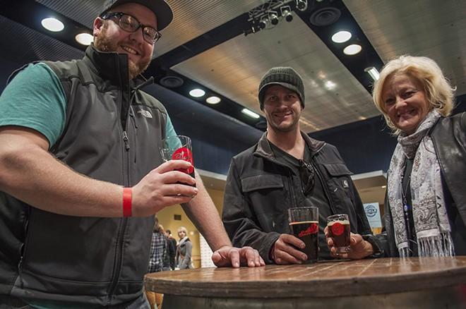 Travis Blanchard, left, Kevin Stone, center, and Donna Walker, right, enjoy the PowderKeg Brew Festival. - SARAH WURTZ