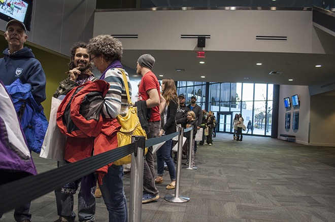 The line inside the convention center before the doors opened for the Snowlander Expo. - SARAH WURTZ