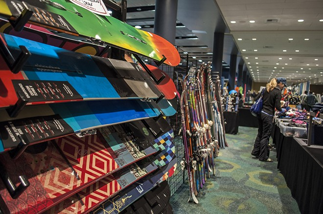 Snowboards and skis at the Tri-State Outfitters booth. - SARAH WURTZ
