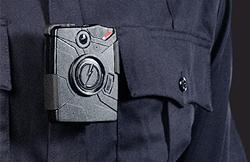 A promotional photo of the chest-mounted Taser Axon Body camera Spokane Police will start wearing in September. - TASER