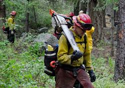 Wildland firefighter working the Cartlon Complex fire in July. - JACOB JONES