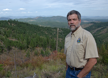 WDFW Region 1 Director Steve Pozzanghera overlooks a grazing area in Stevens County. - JACOB JONES