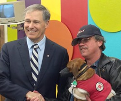 Governor Jay Inslee shakes hands with a client at Volunteers of America Thursday April 2. - LAEL HENTERLY