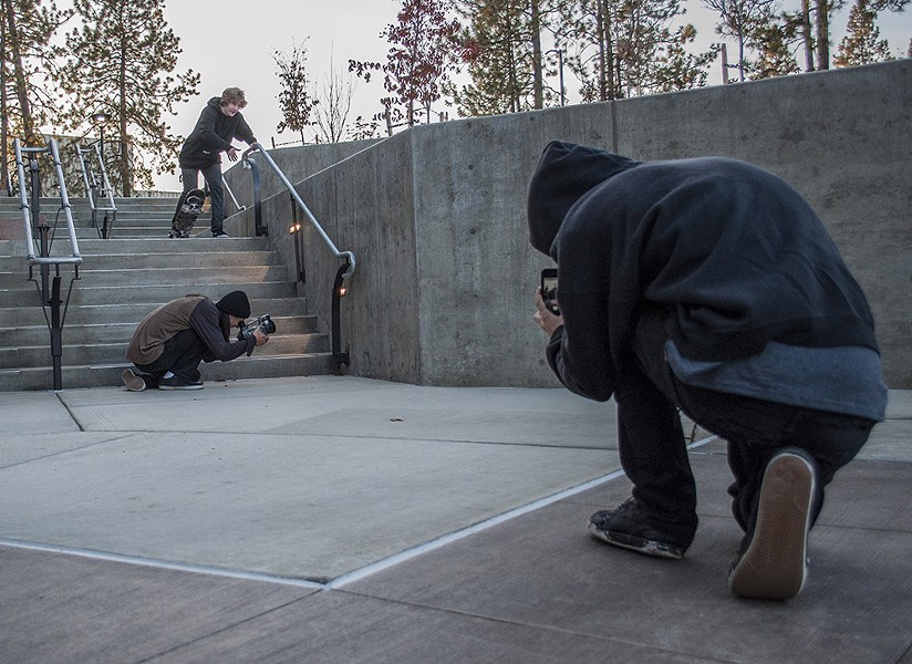 Visintainer, Marko and Nate Akers, front, set up a shot for a trick. - SARAH WURTZ