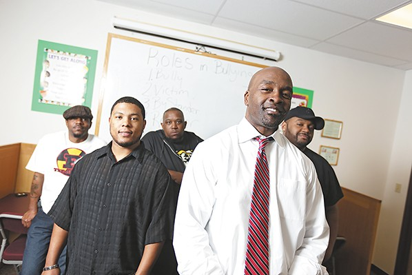 Tommy Williams, second from the right, trains students to combat bullying. - YOUNG KWAK