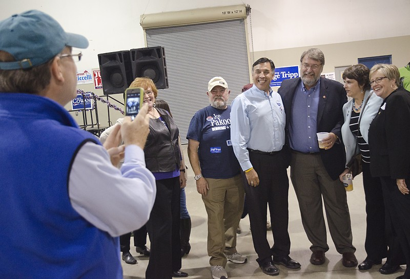 Congressional candidate Joe Pakootas, center, gets a photo with labor leaders. - JACOB JONES