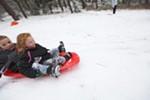 Nine-year-old Samuel Bakken, left, and his 7-year-old sister, Emily, sled at Underhill Park.