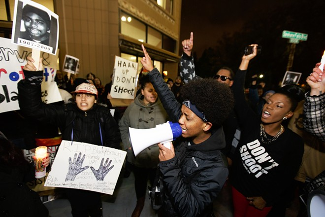 Nineteen-year-old Joshuena Williams, center, leads a chant in front of City Hall. - YOUNG KWAK