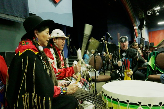 Nora RedFox BrownEagle, left, of the Blackfeet Nation, Dave BrownEagle, center, of the Spokane Tribe and Ho-Chunk Nation, and Robert Wynecoop, of the Spokane Tribe, drum. - YOUNG KWAK
