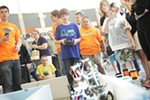 North Pines Middle School 7th grader Brenden Kaiser attempts to navigate his robot on an obstacle course during the MINDS-i competition.
