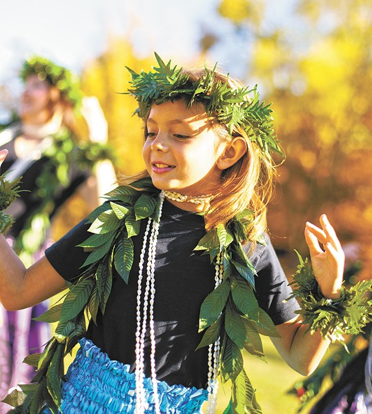 Northwest Hula Company's Maddy Pearson, 8, practices with her dance troupe before the Spokane Fall Folk Festival. - YOUNG KWAK