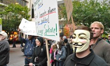 Occupy Spokane takes to the streets, goes to the bank