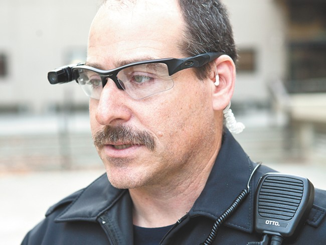 Officer Vic Carroll, wired with the two cameras the department is trying. - STEPHEN SCHLANGE